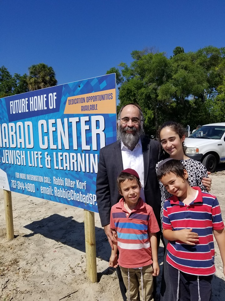 Rabbi Alter Korf and his kids standing at the future site of the Chabad Center for Jewish Life and Learning in Downtown St. Pete