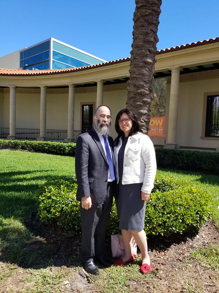 Rabbi Alter Korf and his wife, Chaya Korf, in front of the Museum of Fine Arts in DOwntown St Petersburg