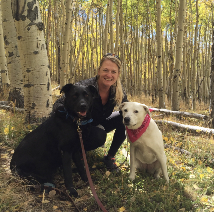 Owner of Book + Bottle, Terra Dunham, and her dogs Apollo and Stella