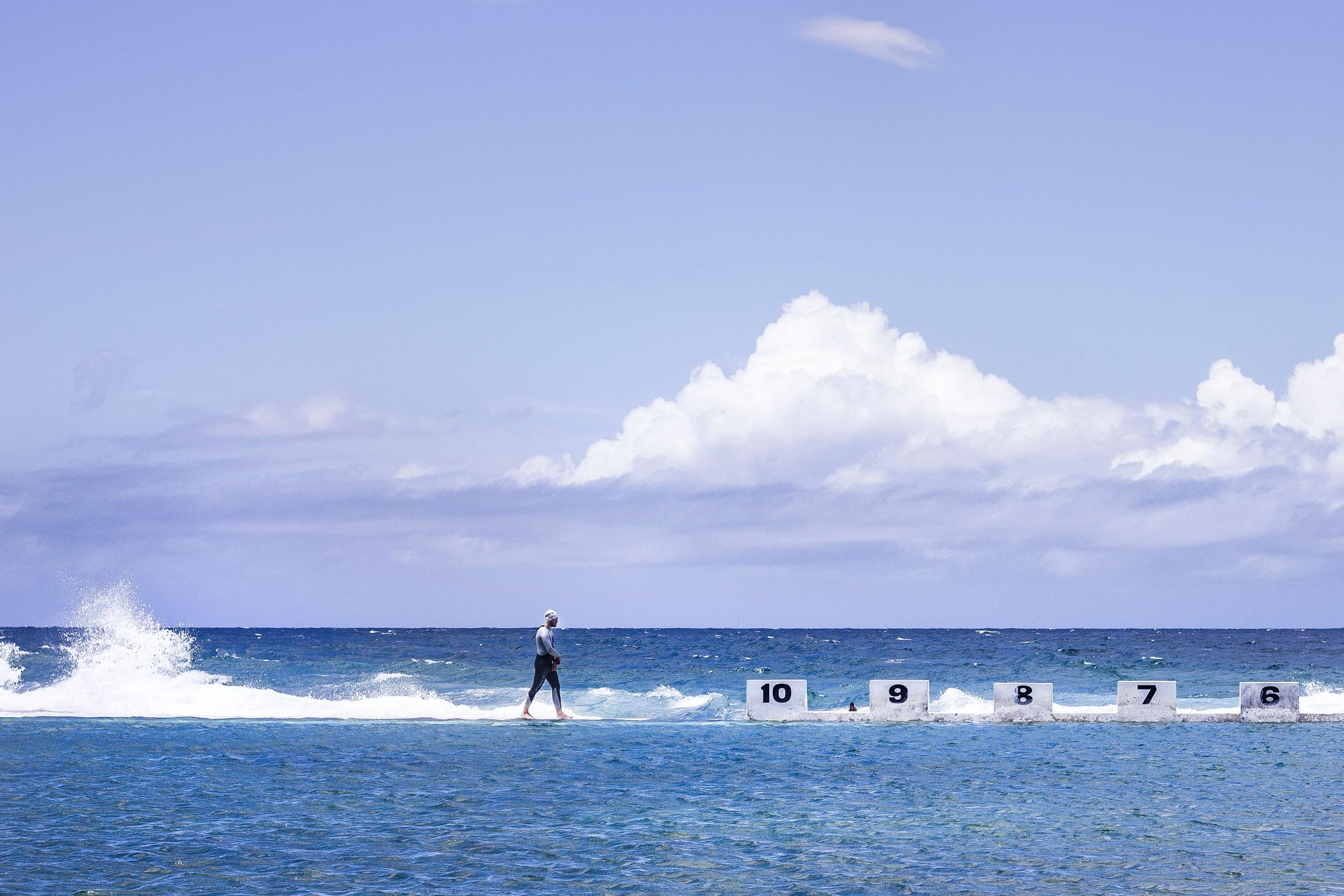 Swimmer at Ocean Bath In Australia