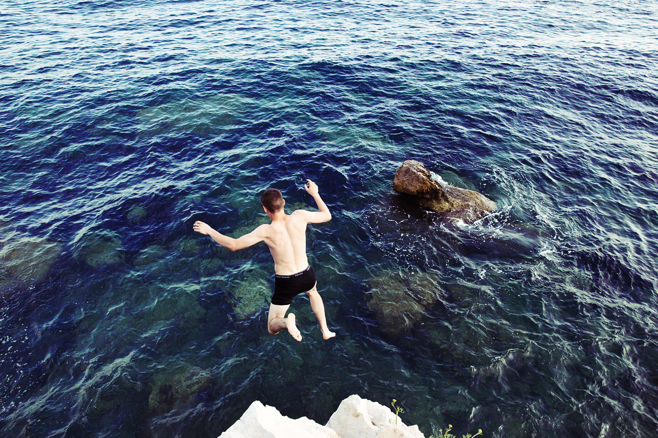 Man jumping into the sea