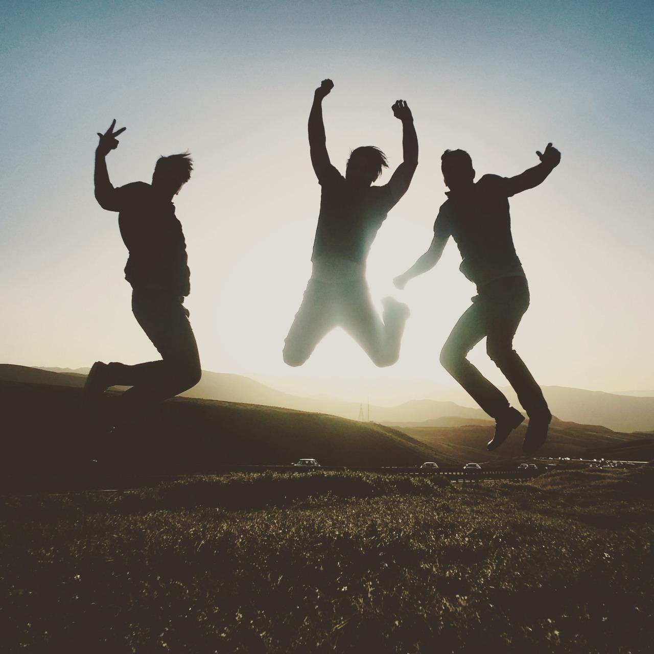 Guys jumping for joy