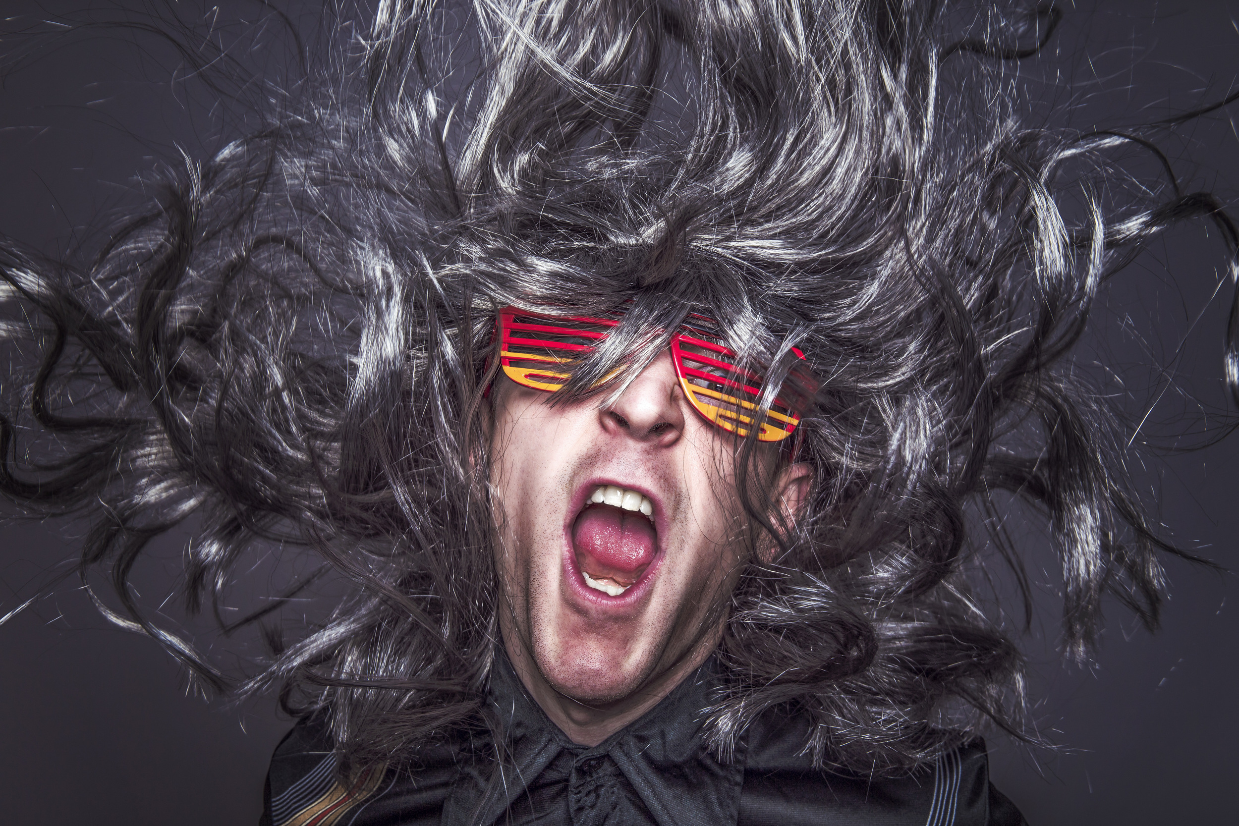 Man in wig with bright sunglasses