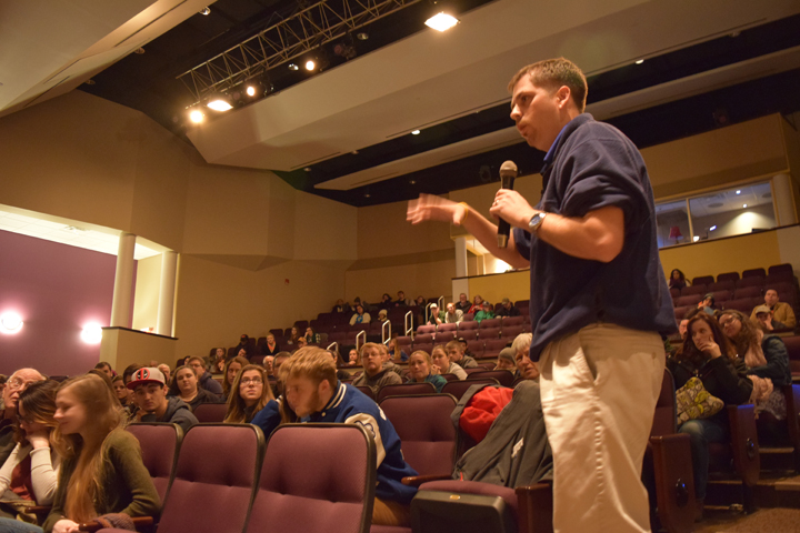 Buckhannon-Upshur High School Teacher, Brent Kimble, asks the panel a question on behalf of the 17 students that attended this event.
