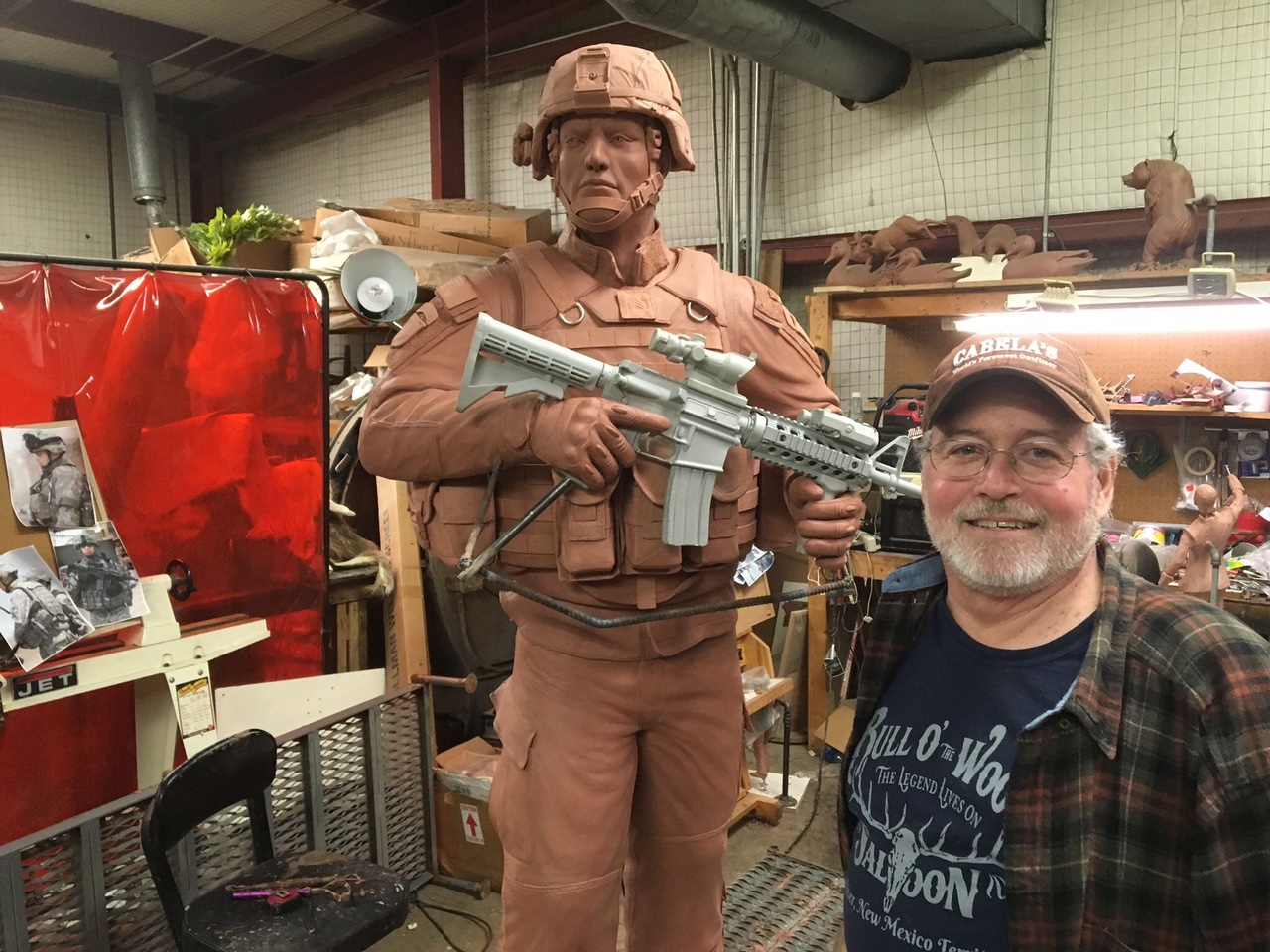 "Artist John Parsons with his sculpture titled ""An American Soldier""."