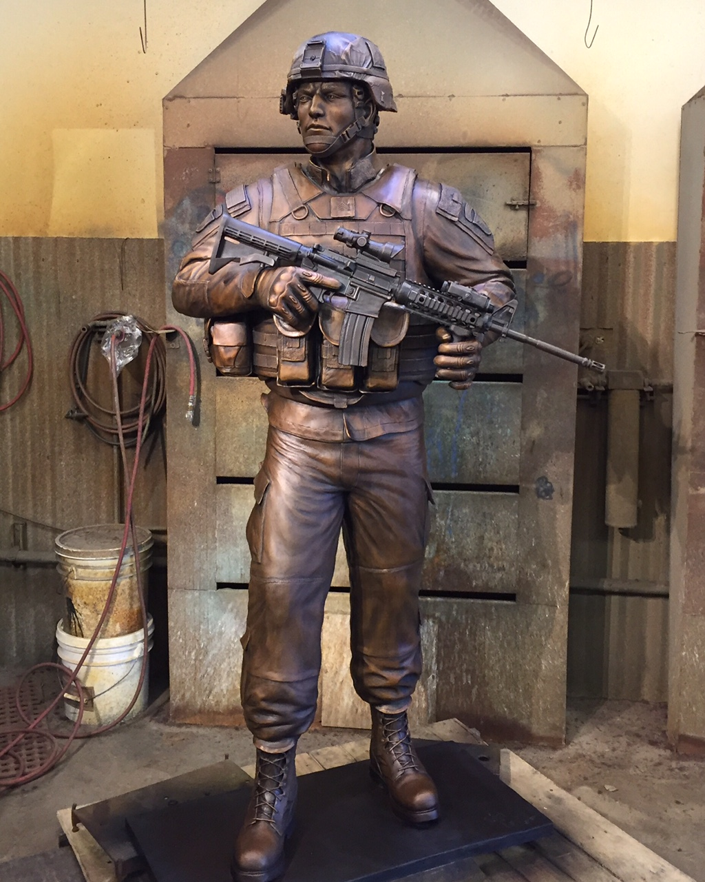 """""""An American Soldier"""" Completed sculpture in the patina room at Art Castings of Colorado."""