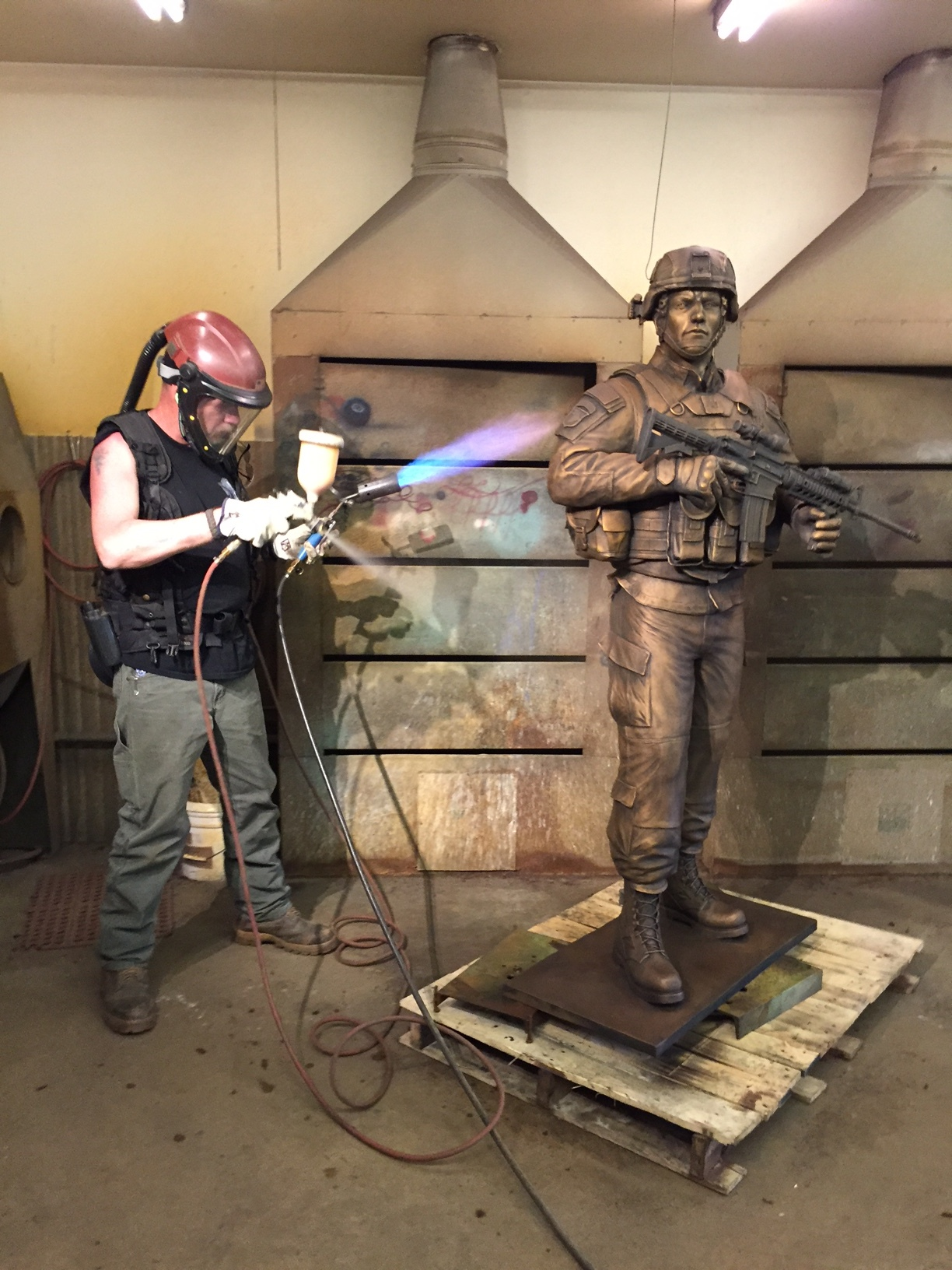 Patina Artist Nate Ford applies Ferric Nitrate patina to the sculpture.