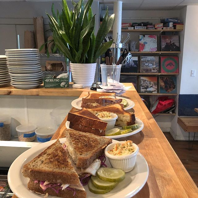 Turkey Rueben and two grilled cheese pose briefly on their way to table 23. #diner #lunchcounter #logansquare #cafelife