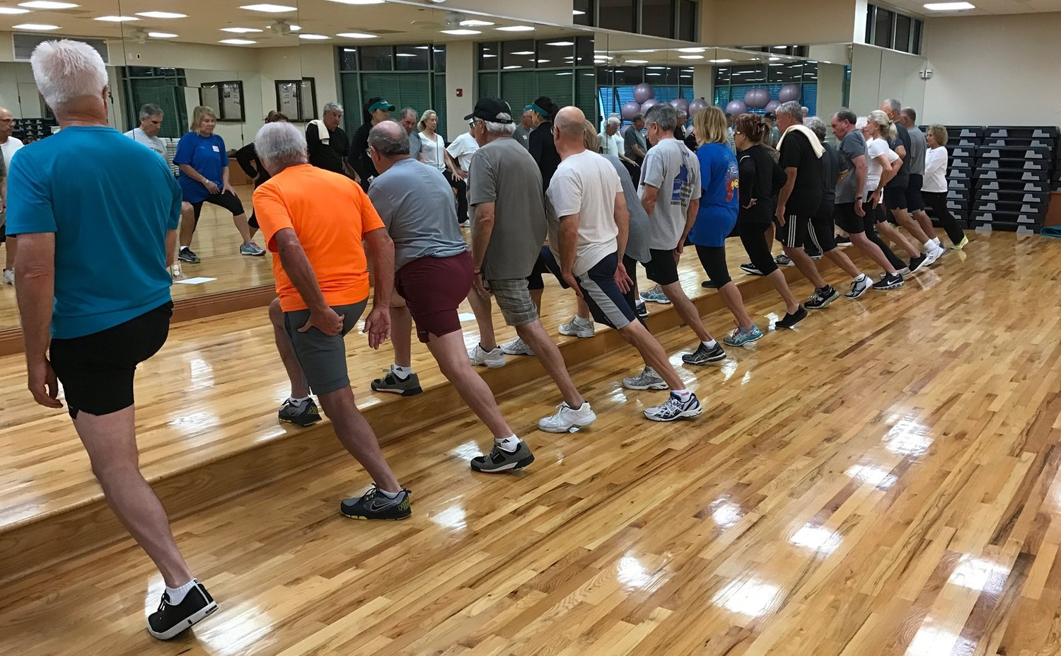 MEMBERS AT A LOCAL COUNTRY CLUB PARTICIPATING IN THE WEEKLY GOLF FITNESS CLASS