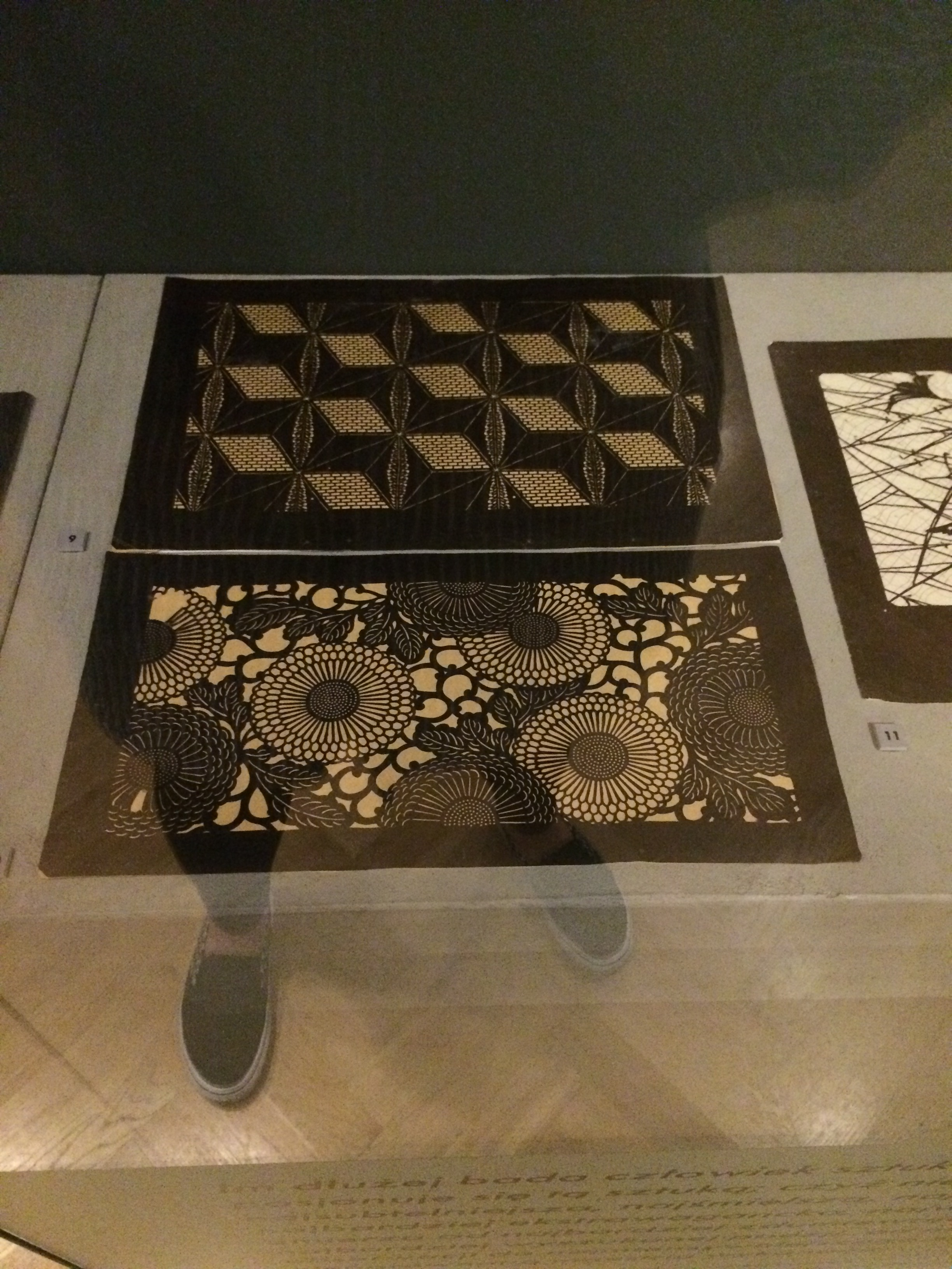 Cut paper, I didn't catch the name of the artist who created these.