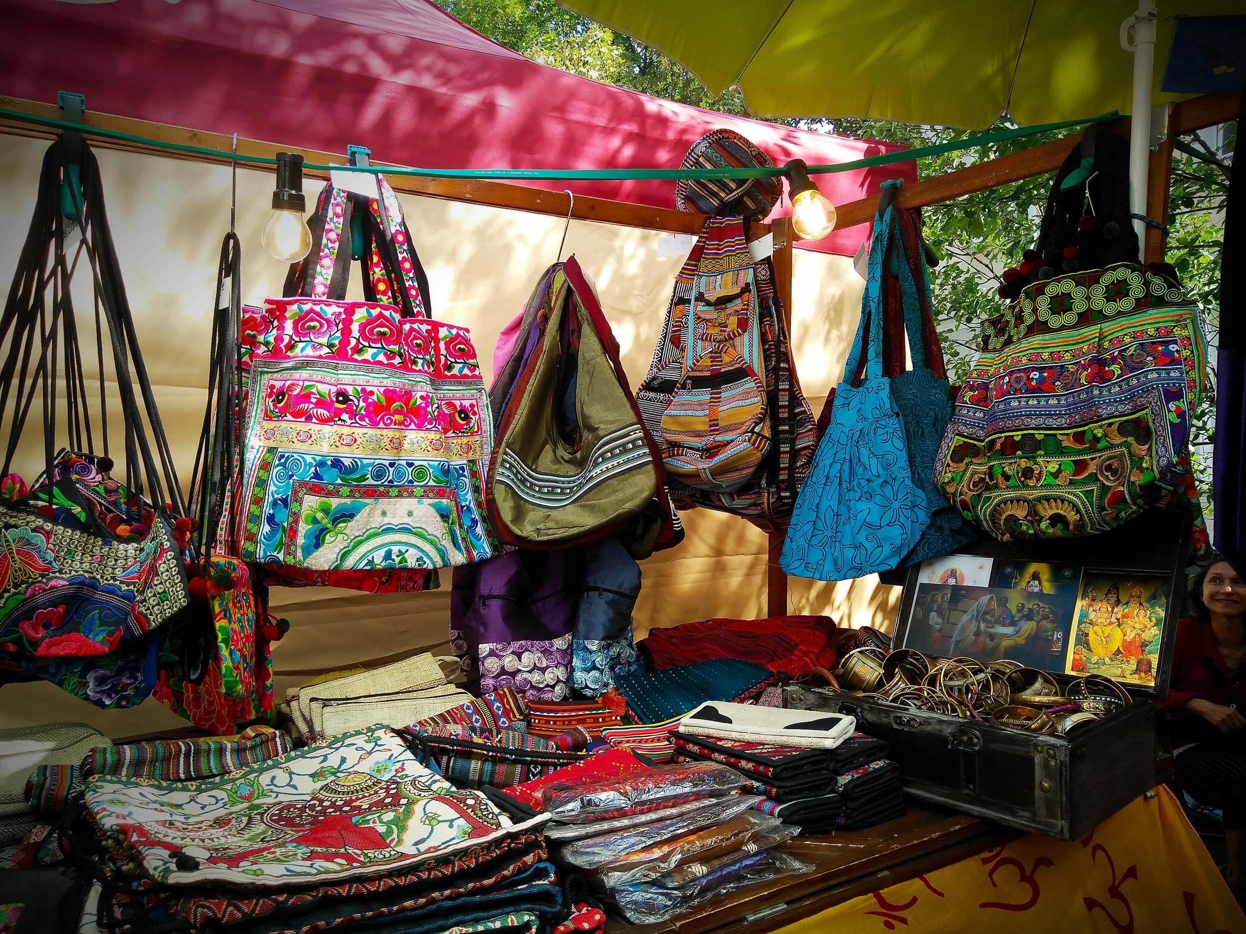 Carnival of Cultures, Berlin, Germany 2019. Miao and Southeast Asian Hmong textile hand bags and wallets mixed with a variety of other textiles.