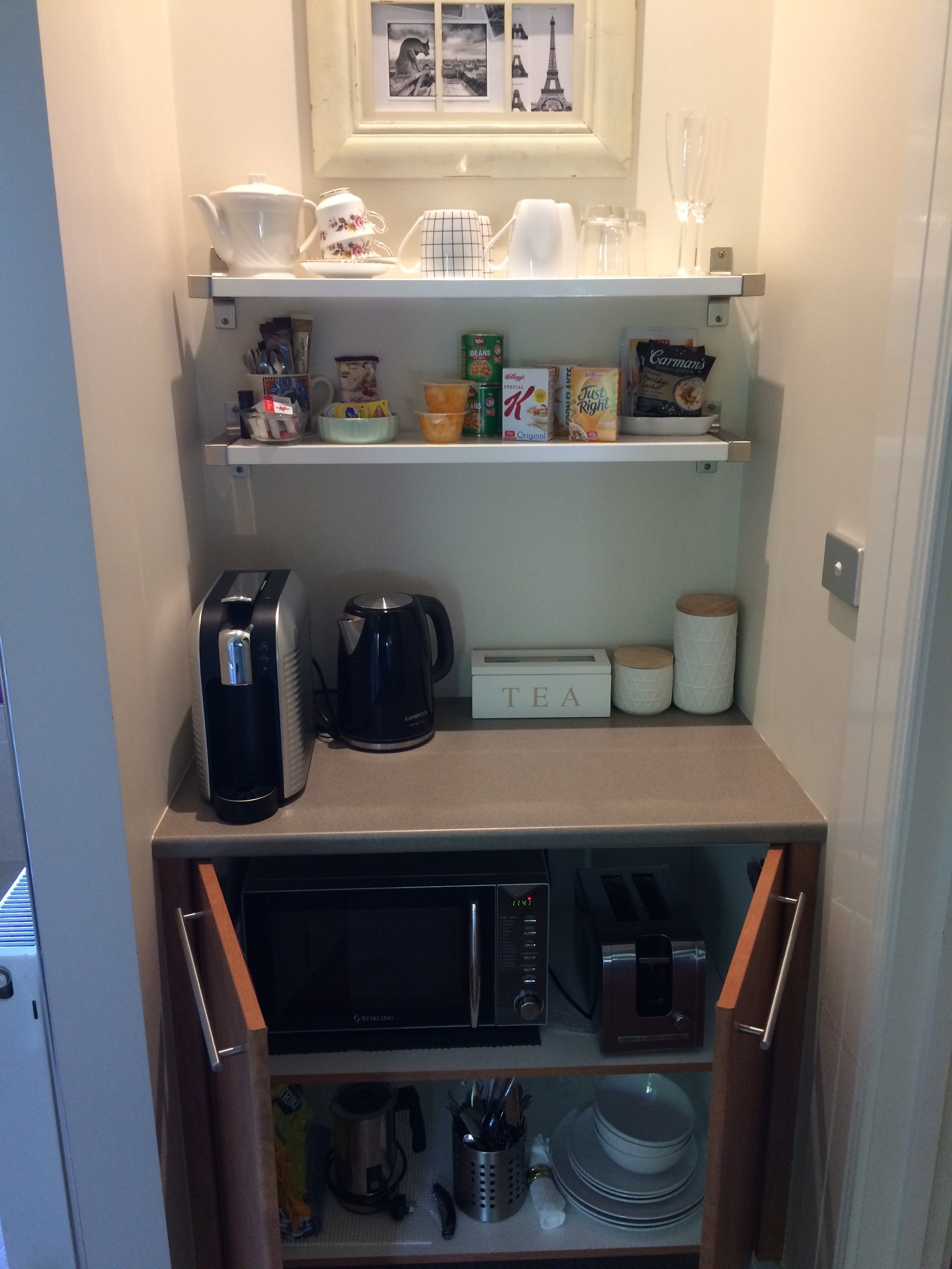 Kitchenette cupboard open.JPG