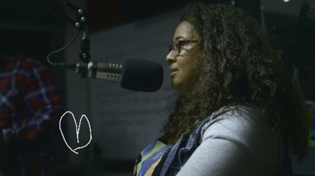 Antoinette being interviewed on Power 98.3 in February 2016 for her annual art exhibition. Photo by Malakai of Malakai Creative.