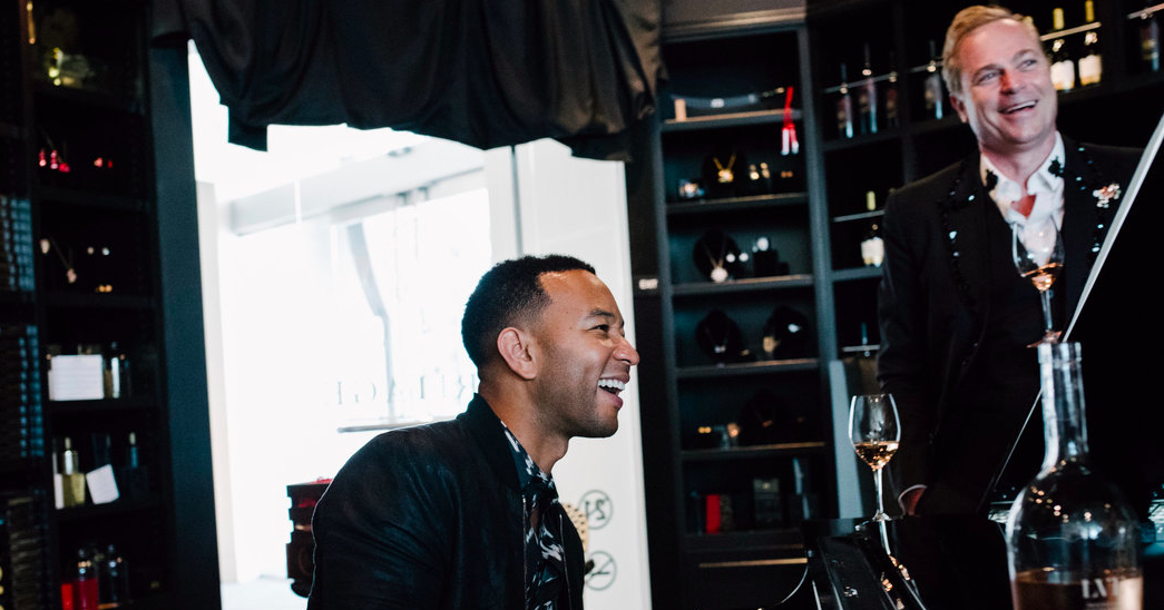 John Legend plays at the piano alongside Jean-Charles Boisset at the JCB | LVE pop up lounge.