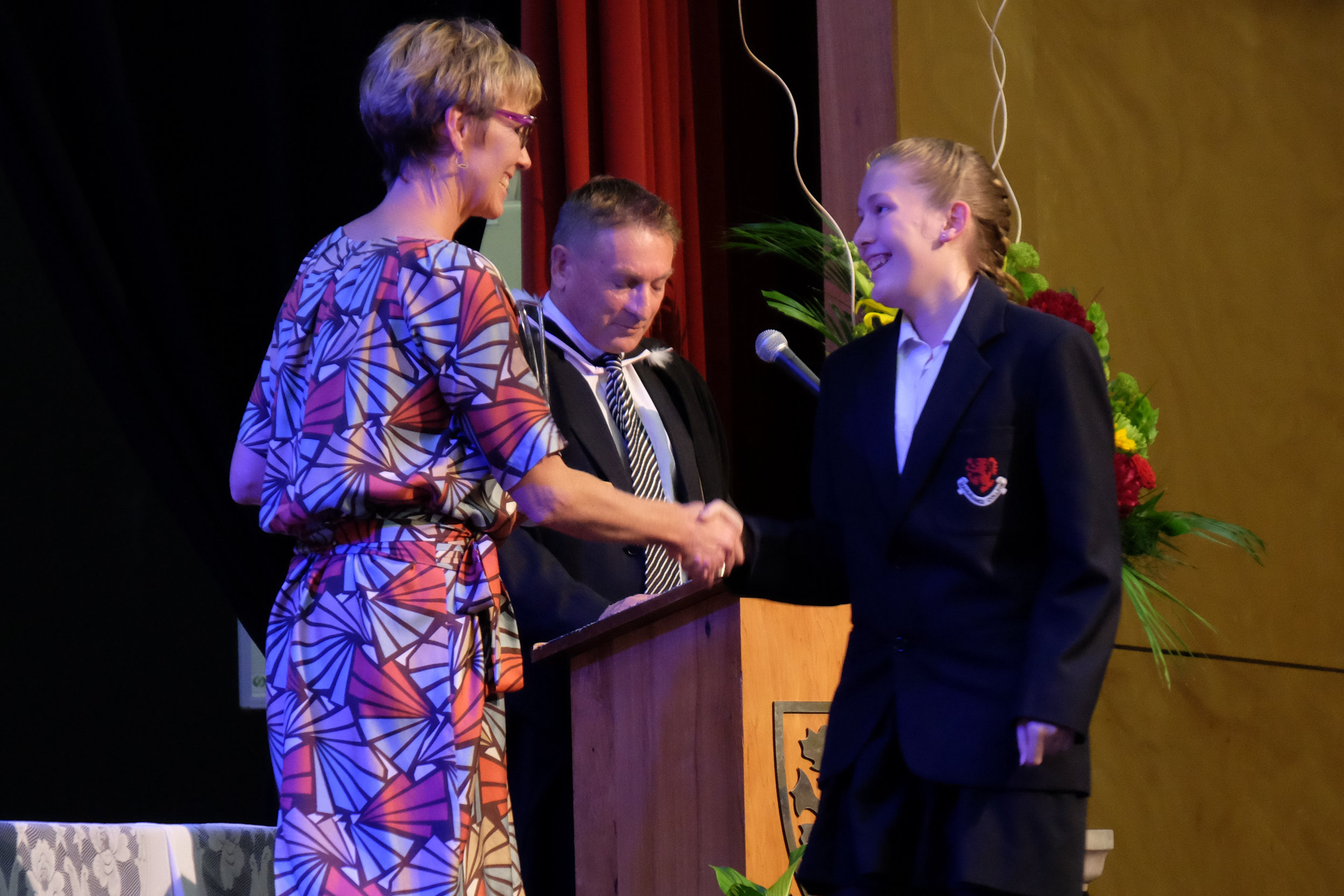 Claire McDonald presenting Hannah Dunn her Science Scholarship