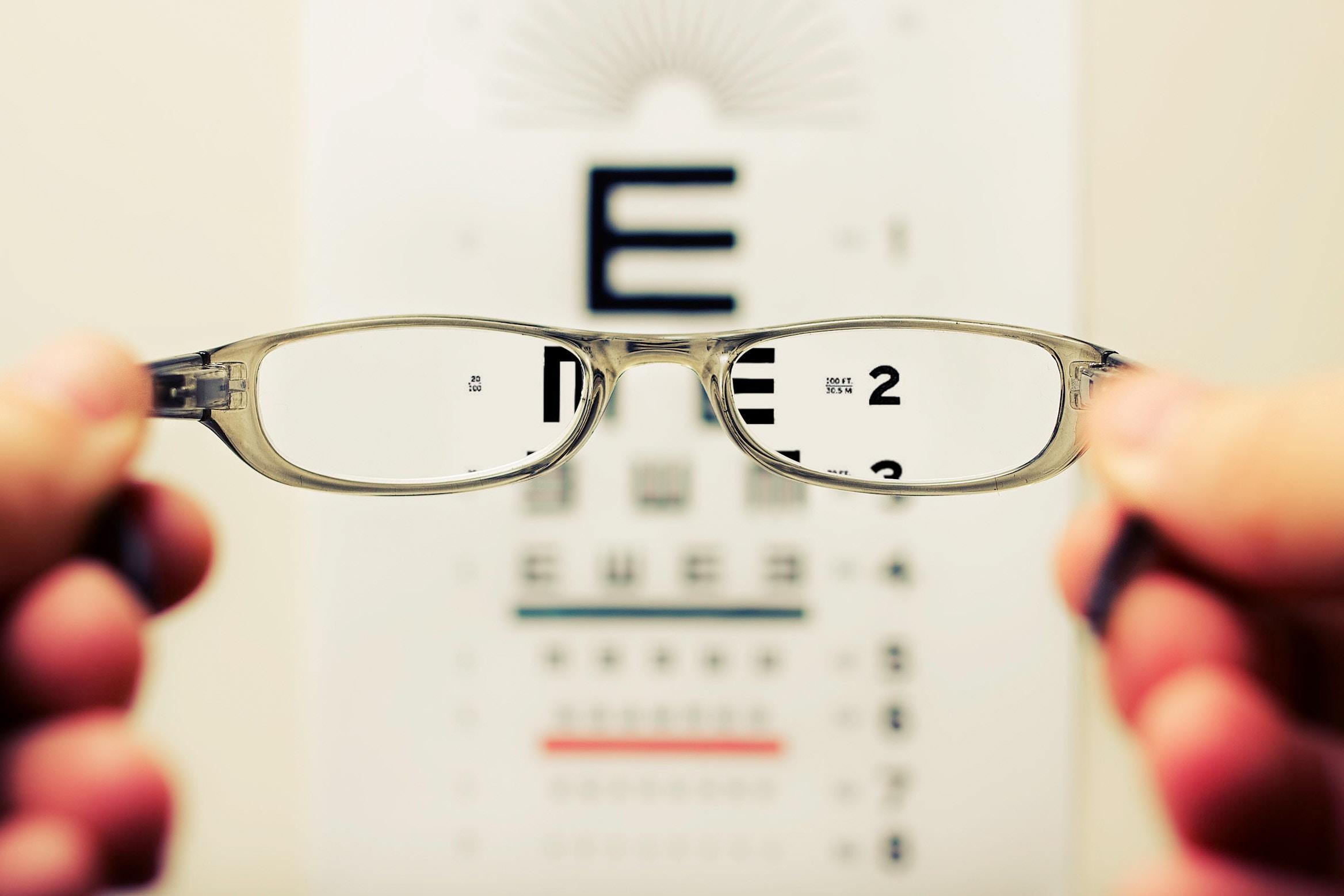 Eye chart blurred with specs.jpg