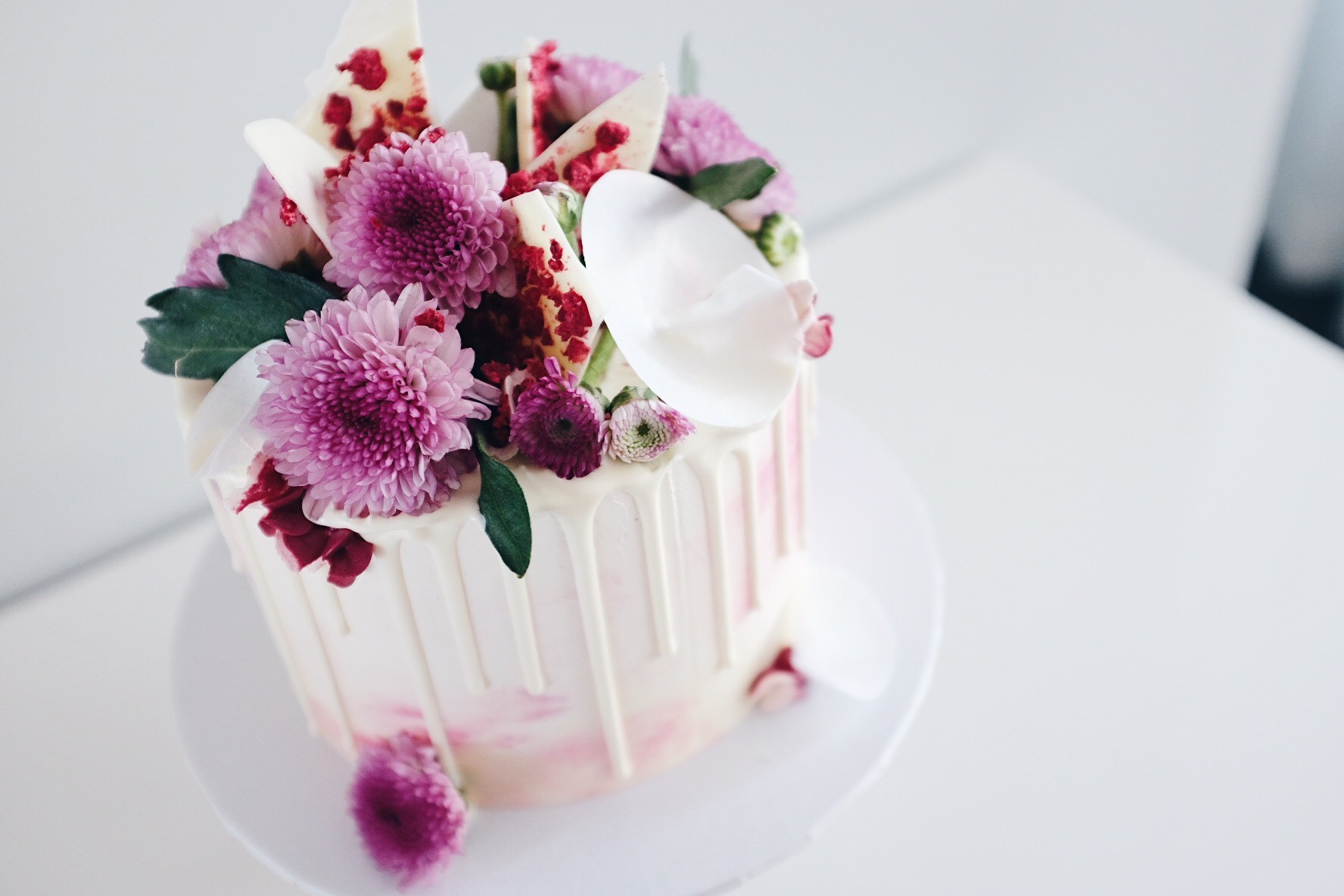 Soft pink watercolour cake with white drips