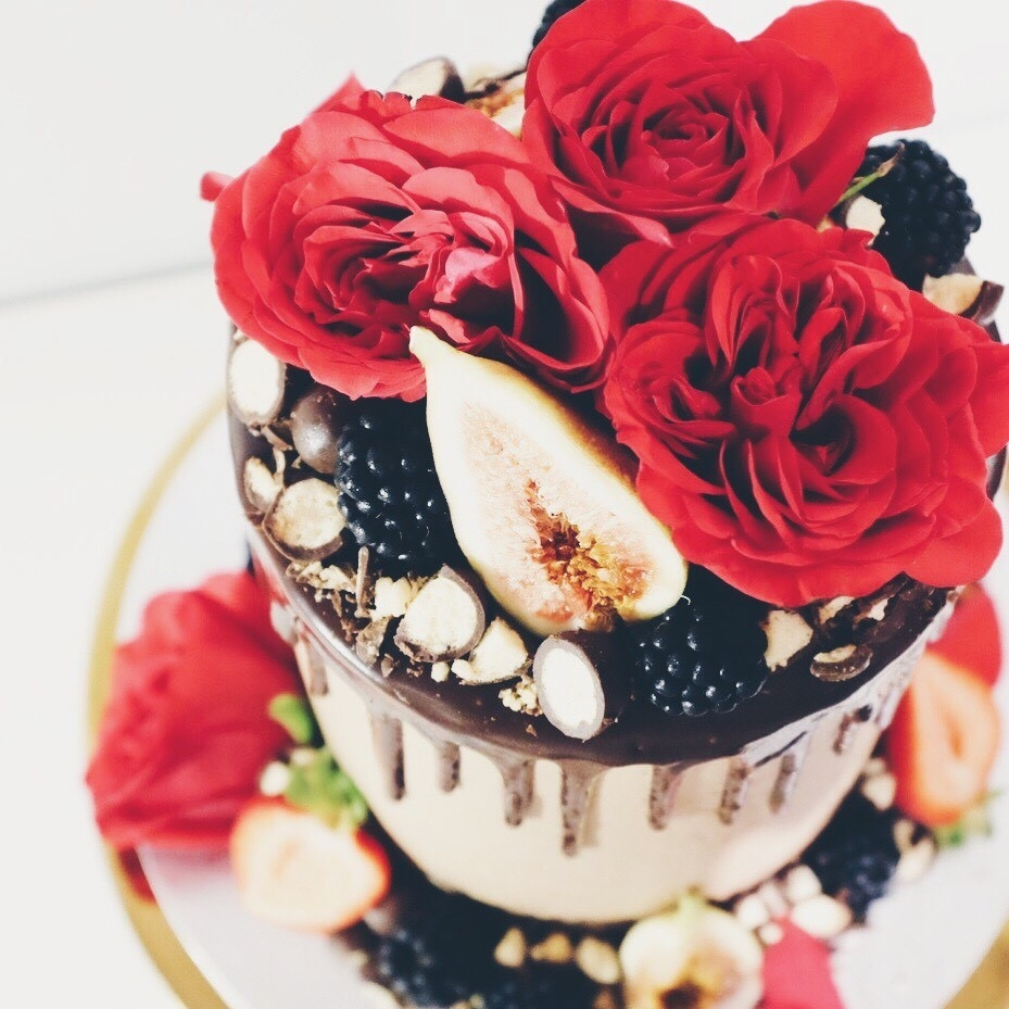 A Valentine's cake with chocolate insides and buttercream, topped with roses