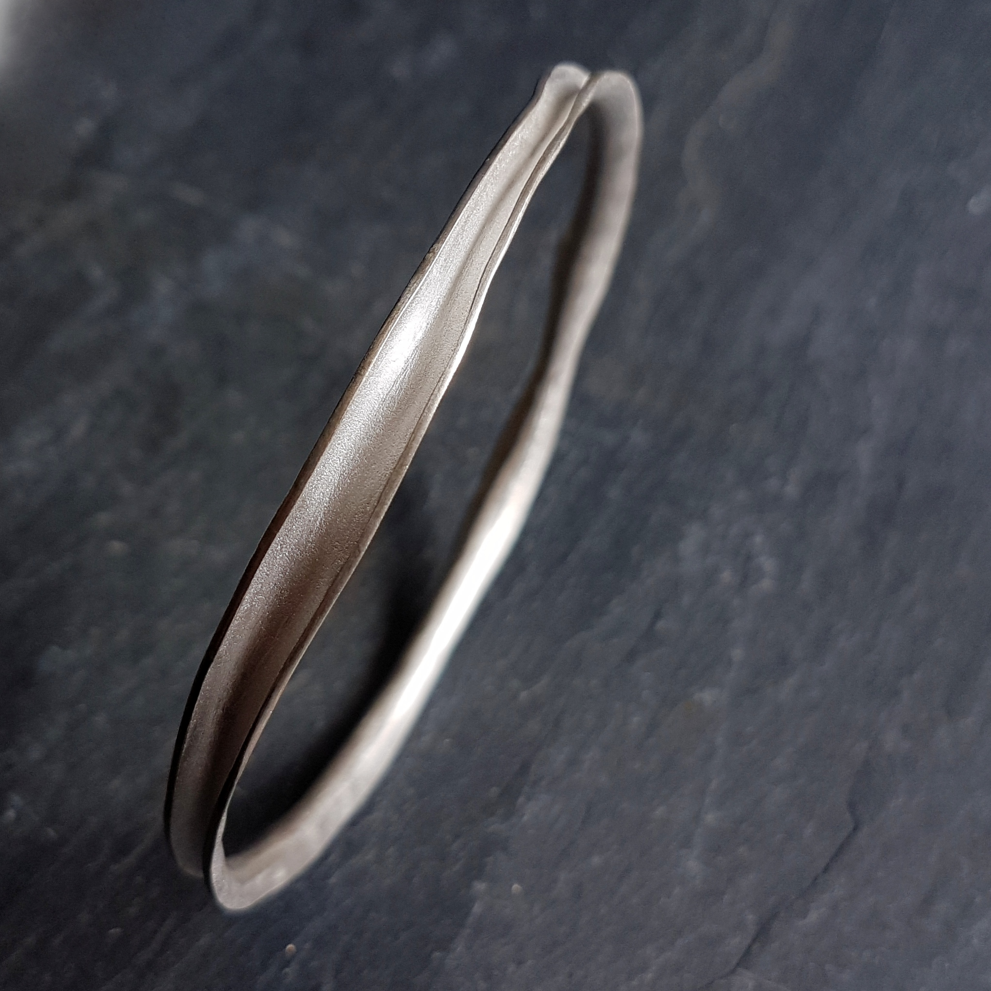 Mara Bangle   The Mara bangle echoes the movement of the sea with a smooth organic shape which makes it tactile and comfortable to wear.