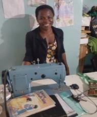 Bernadette teaching sewing