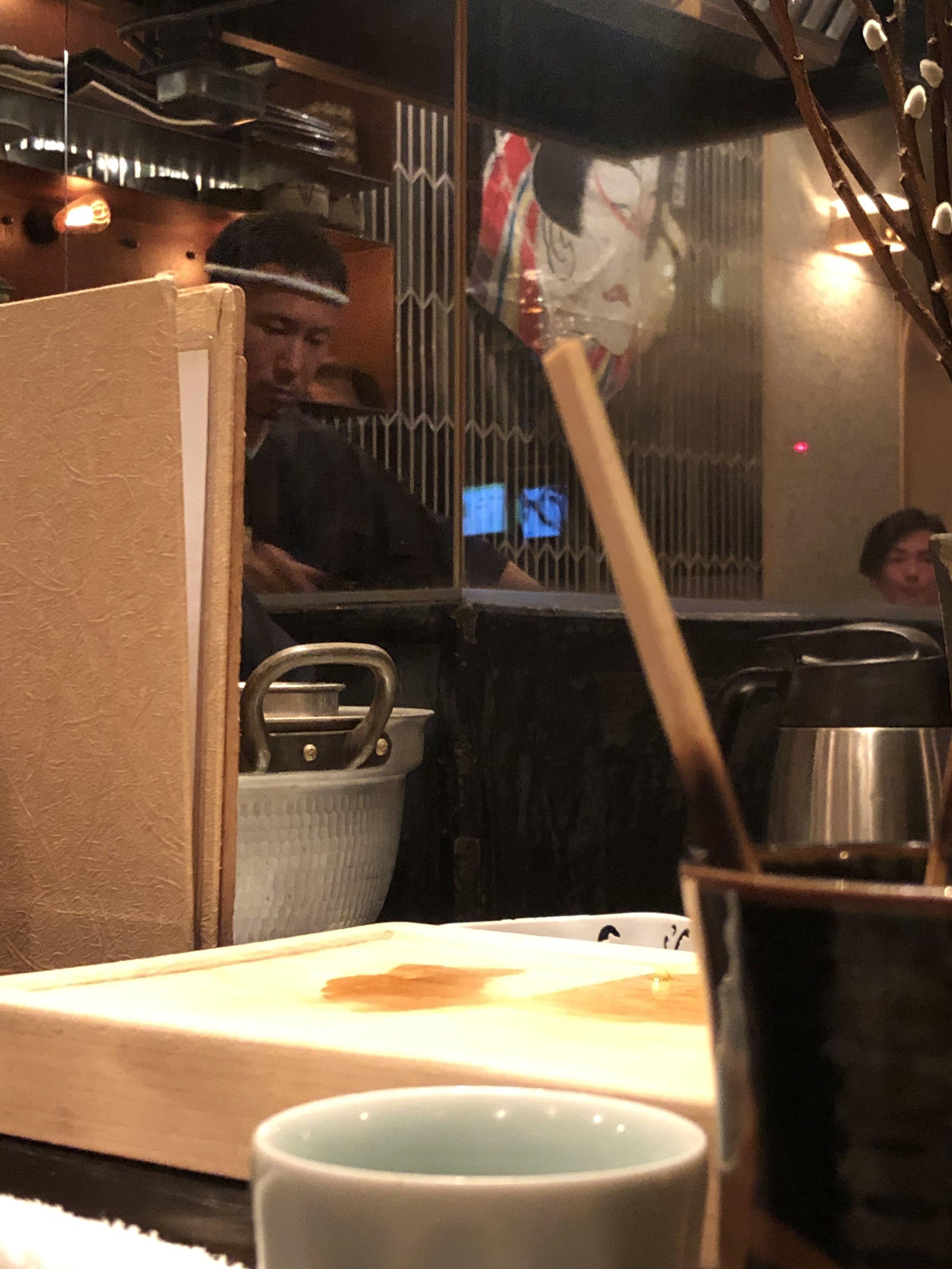 Yakitori chef preparing the horsemeat