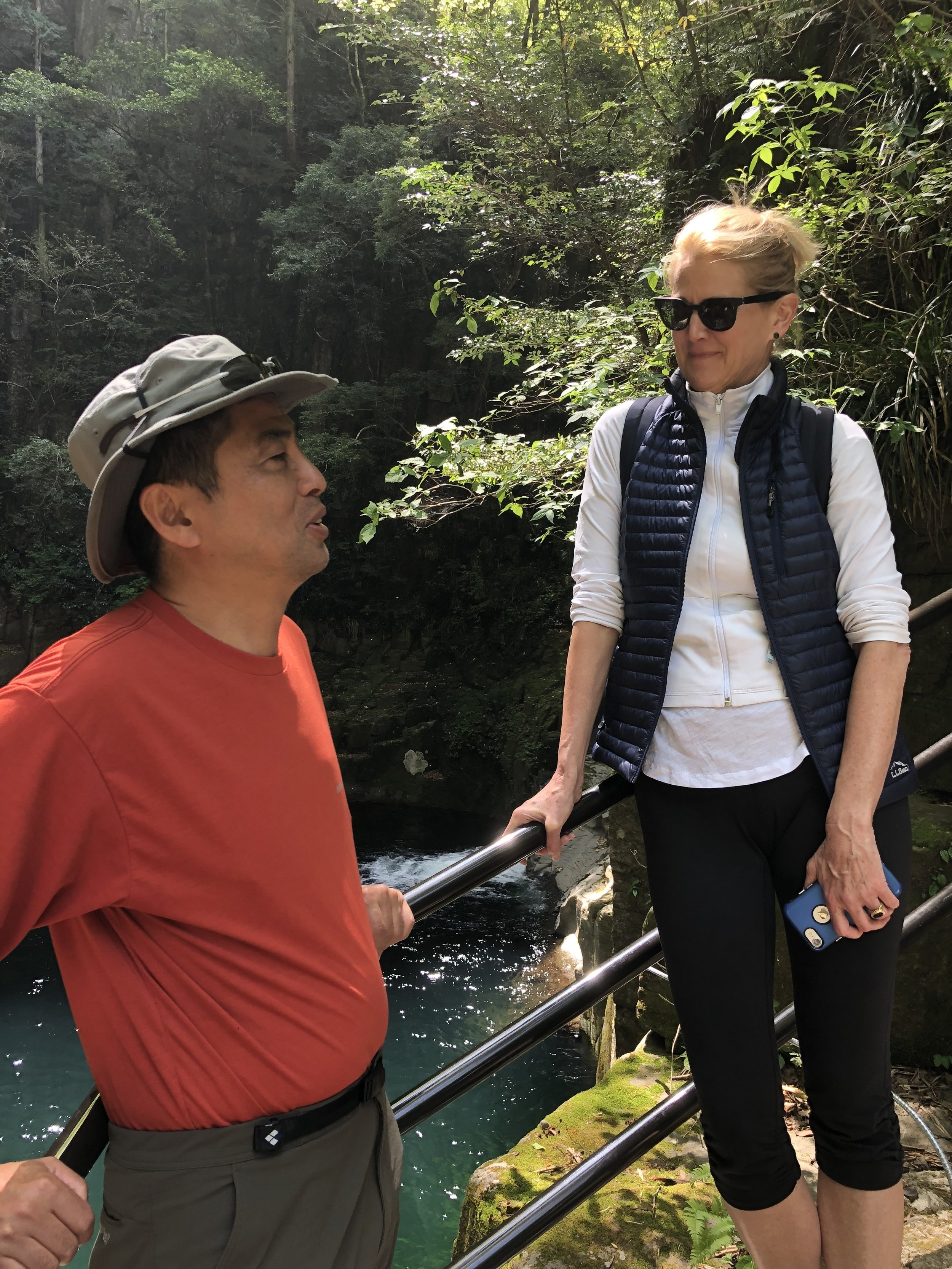 Katie with our guide, host and monk at Akame Falls (Ninja training area)