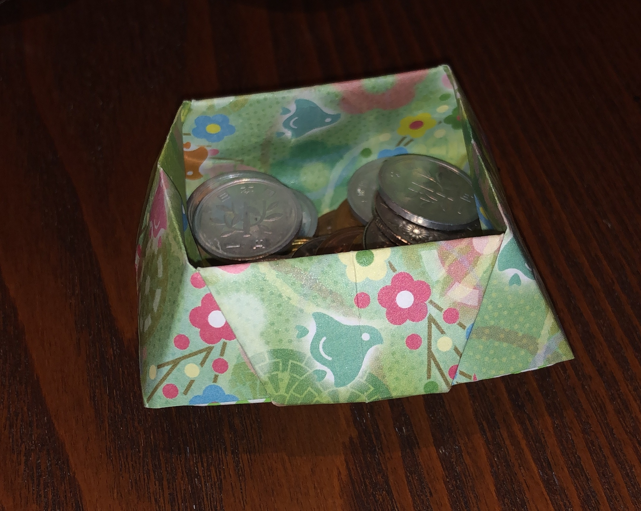 Origami coin holder
