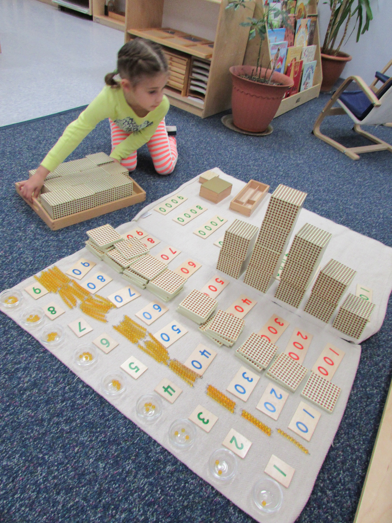 Some Primary 3 student spracticed linear counting with the Hundred Board while another student used the decimal system materials to associate numbers and quantities while learning place value.