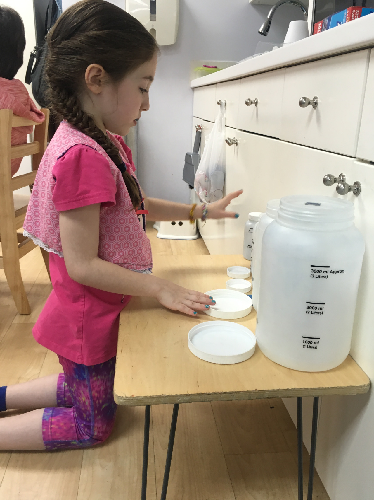 A second year Lower Elementary West student worked on the follow up for the Liquid Measurement Lesson.
