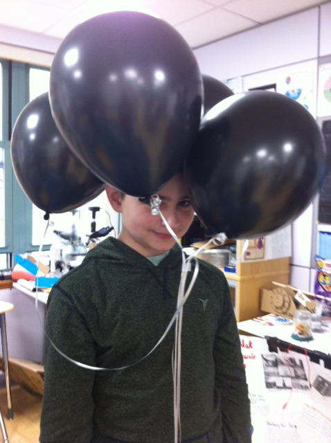 A Middle School student created a new hat as he experimented with static electricity.