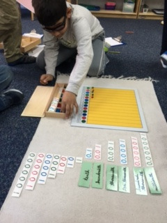 The third grade Lower Elementary West students learned about decimals using the Decimal Board material.