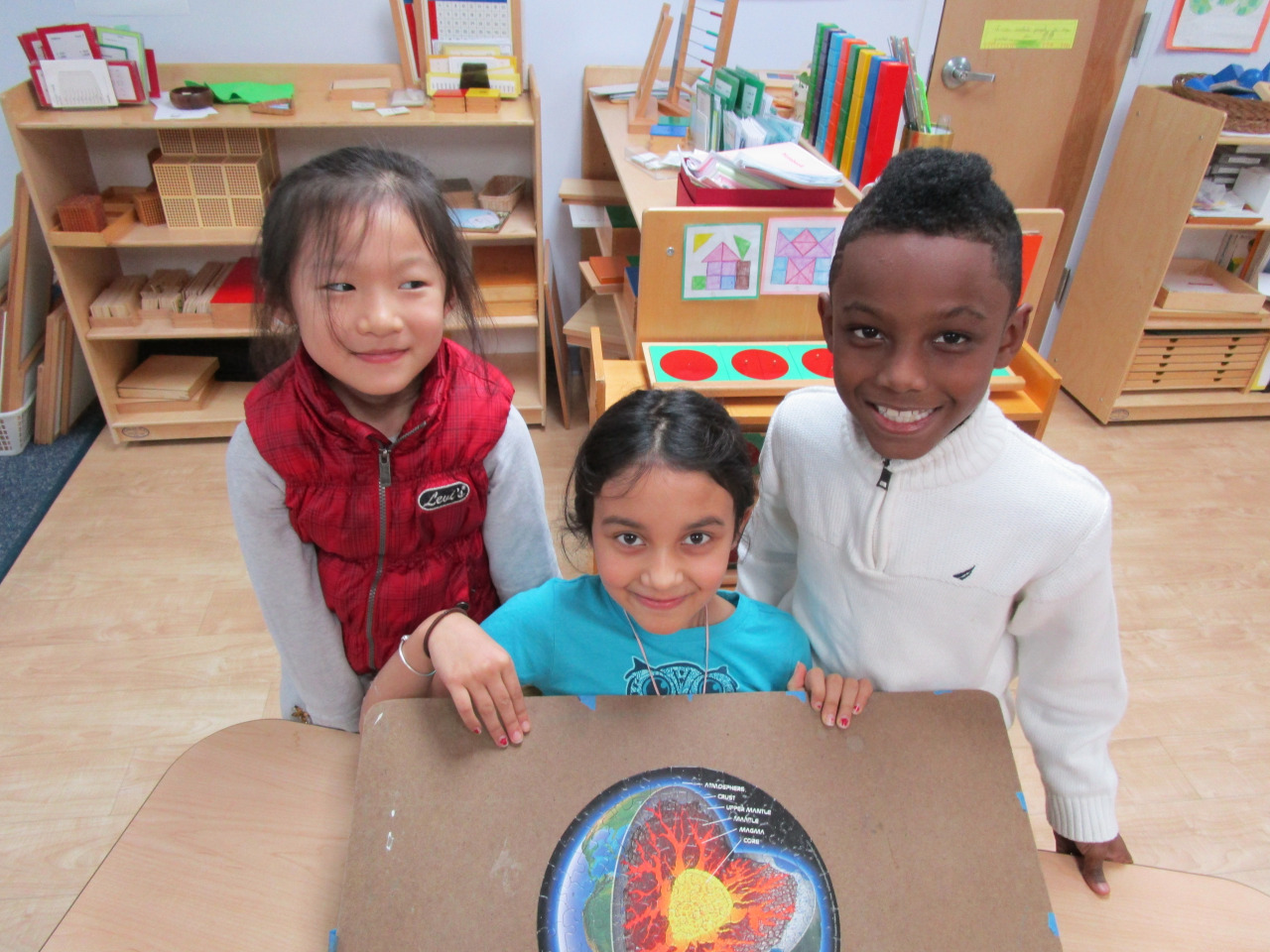 Lower Elementary North students were excited to share their completed puzzle illustrating the layers of the Earth.