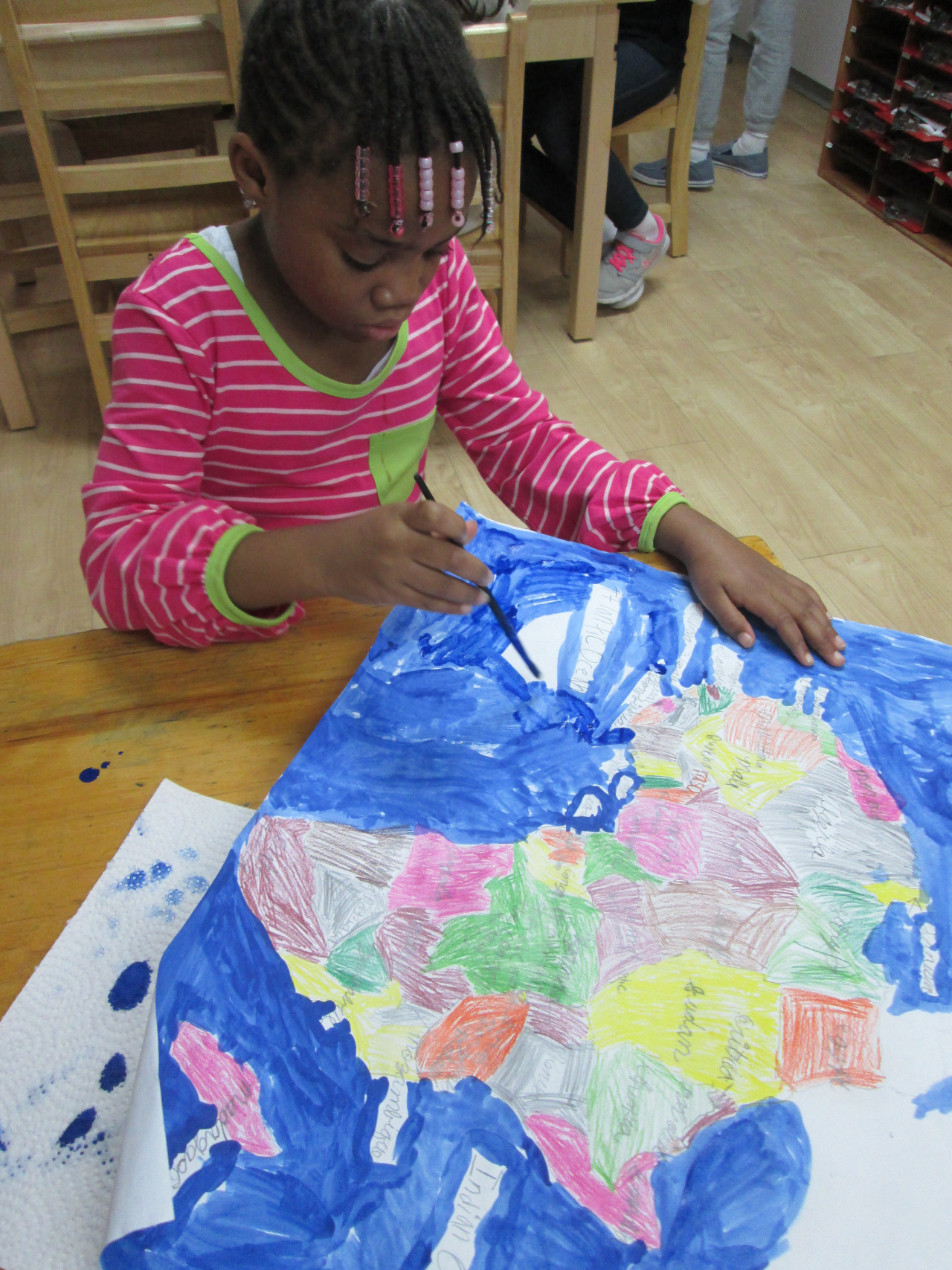 Lower Elementary East students continued to study the continent of Africa. Before painting, a first grade student traced and labeled the countries, labeled each corresponding capital and identified other elements of her map, then completed the final touches.
