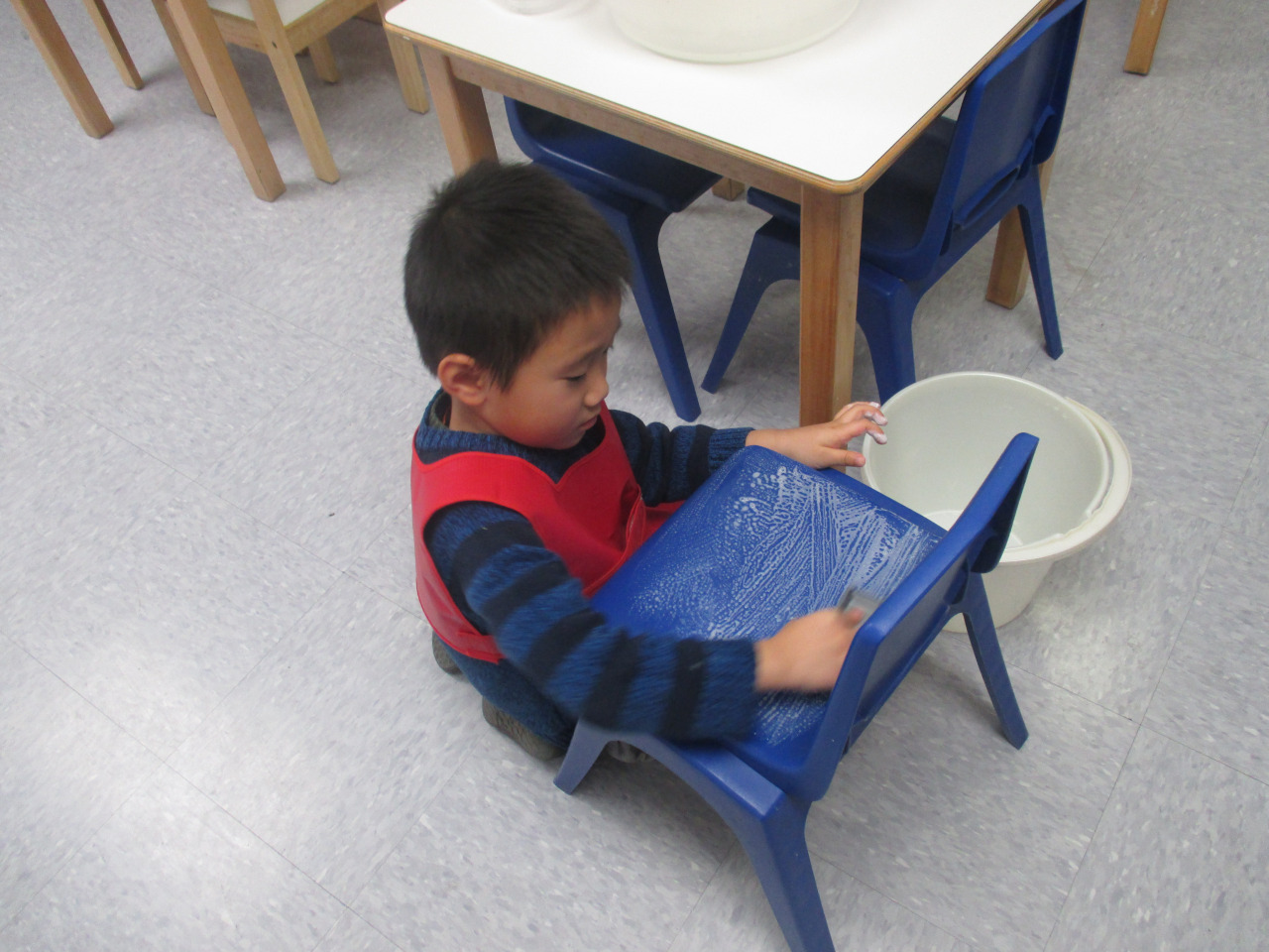 The Primary 1 Kindergarteners took pride in scrubbing their own chairs.  They marked them with their name tags and then sat on them during lunch time.