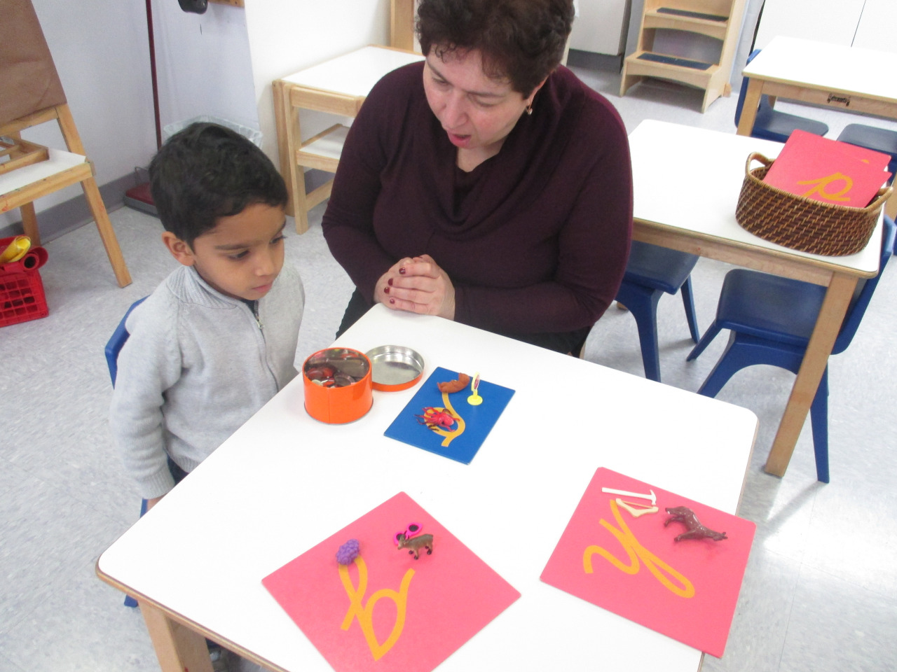 After the Winter break, the Primary 1 students got right back to work on their lessons.  One student received a lesson about letter sounds using Sandpaper Letters and objects.