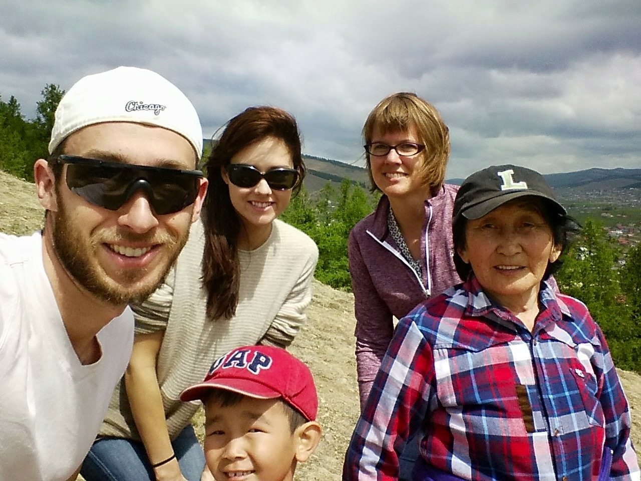 Hiking the mountain above our camp with Adam, Claire, Khongi's son and grandma