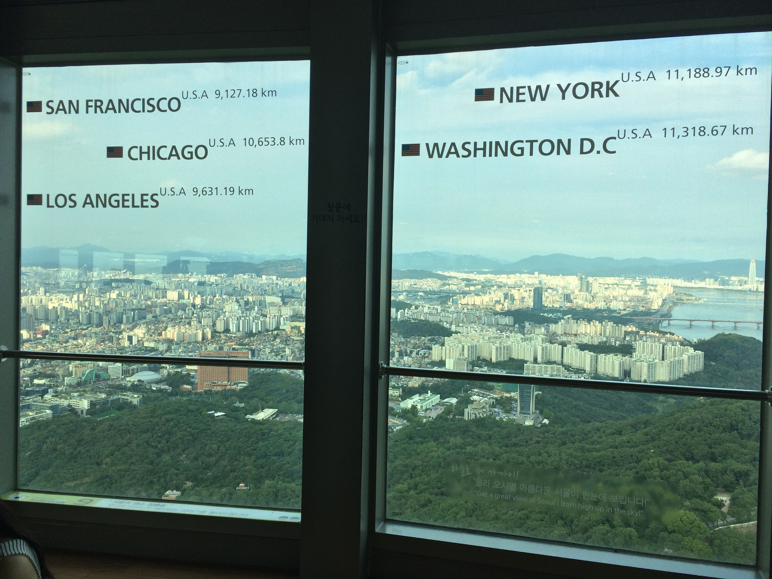 At the top of the Seoul Tower, the windows each depict the distance to cities worldwide in that particular direction. Boston is this general direction.....