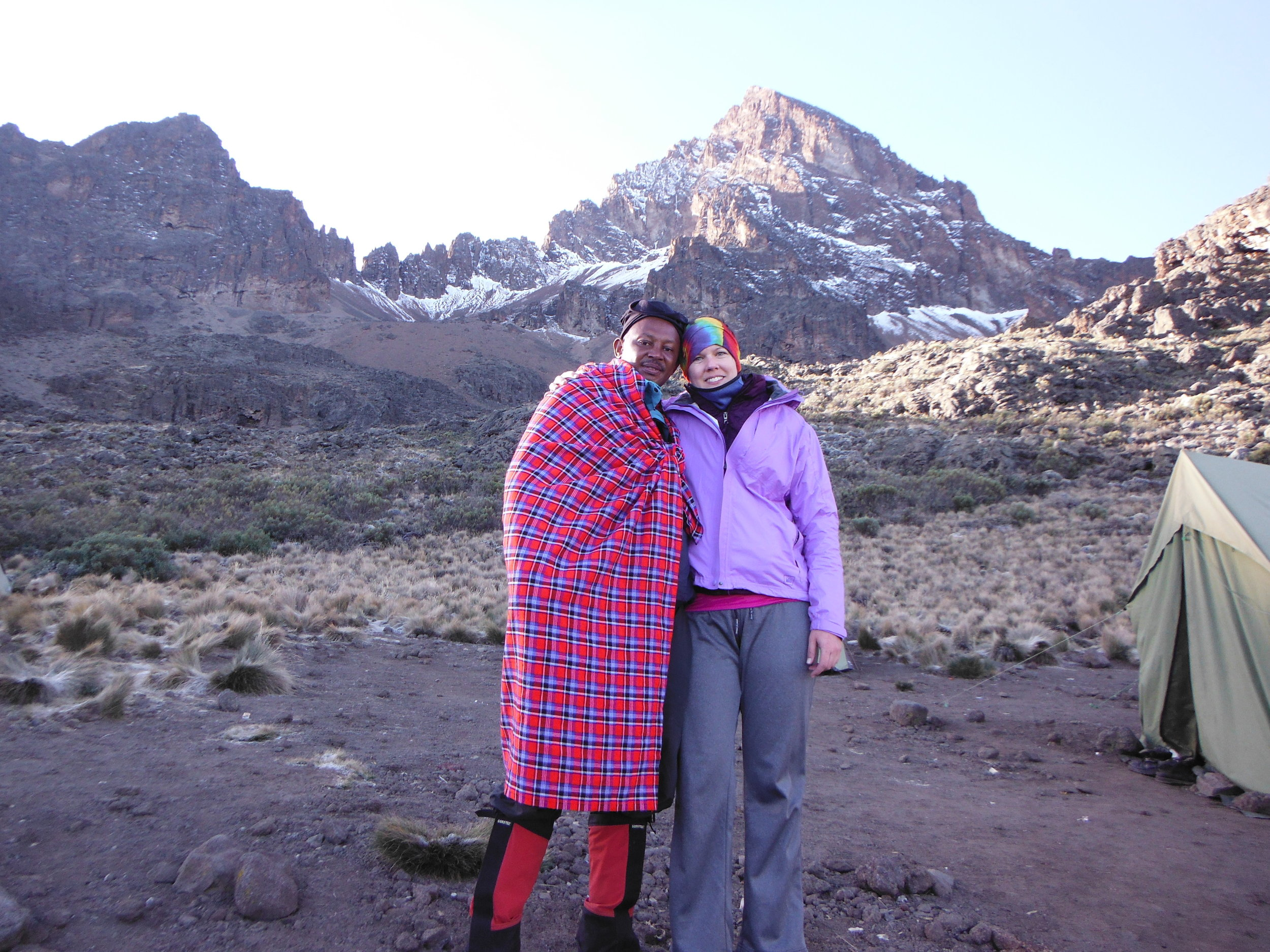 With Makeke. It was a cold morning ... though not as cold as summit night!(Mt Mawenzi in the background, which we scaled the afternoon prior in an acclimatization hike from camp)