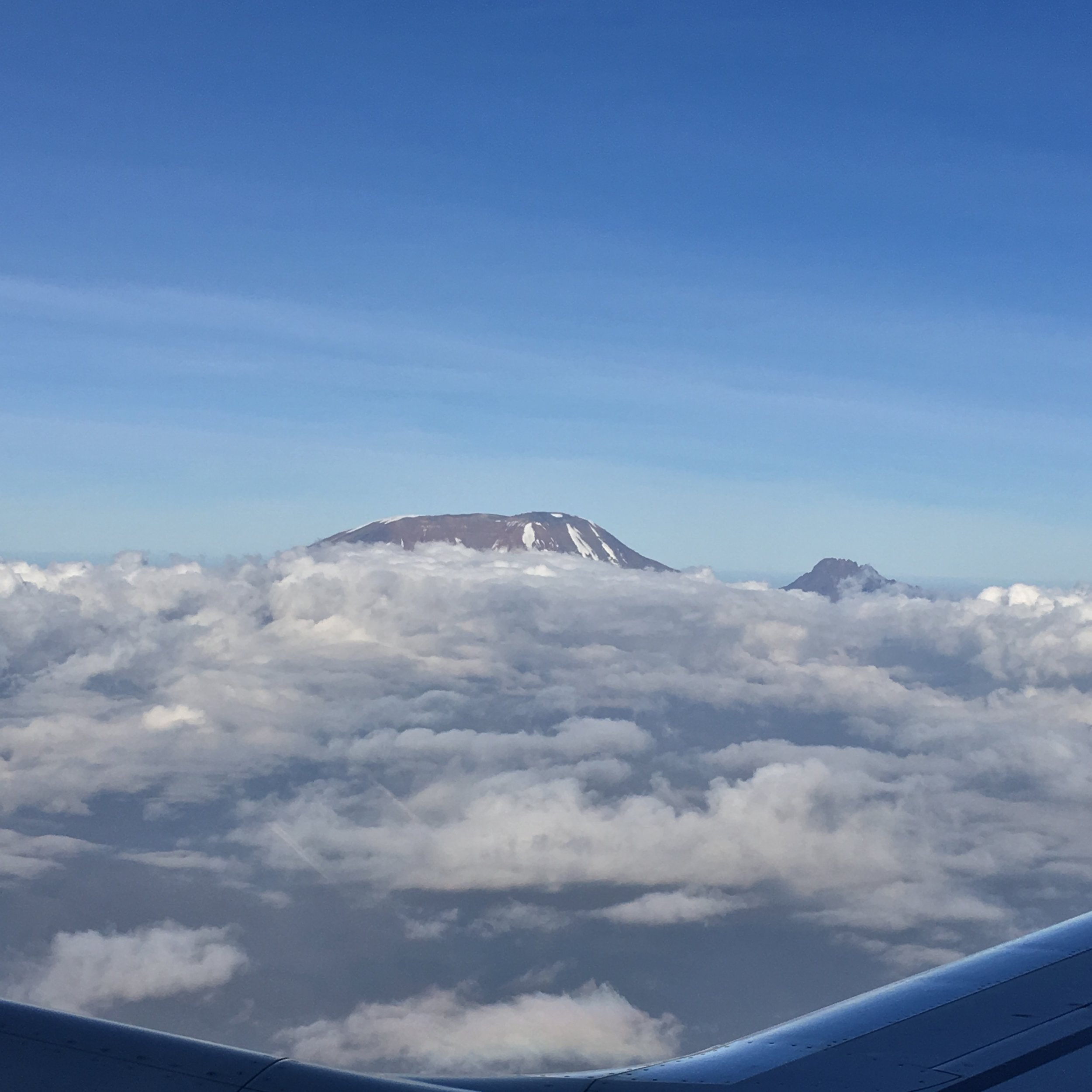 A final perspective from the airplane headed home. Kili on the left, Mawenzi standing tall on the right.I was in tears looking at this, in disbelief of what I had accomplished.