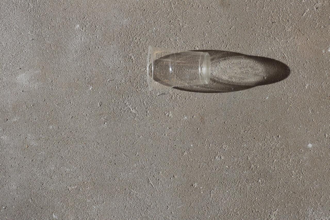 Plastic cup, concrete, shadow Mundane 2018
