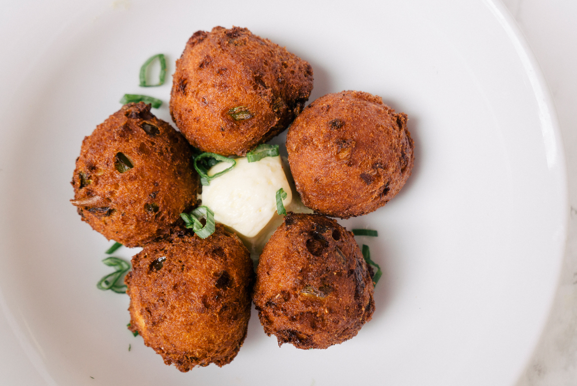 CRAZY FETA HUSH PUPPIES   CORNMEAL, CRAZY FETA, HONEY-BUTTER