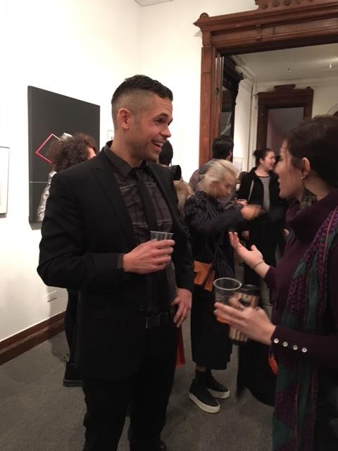 Jon Levy, Gallery House Program Coordinator greets patrons