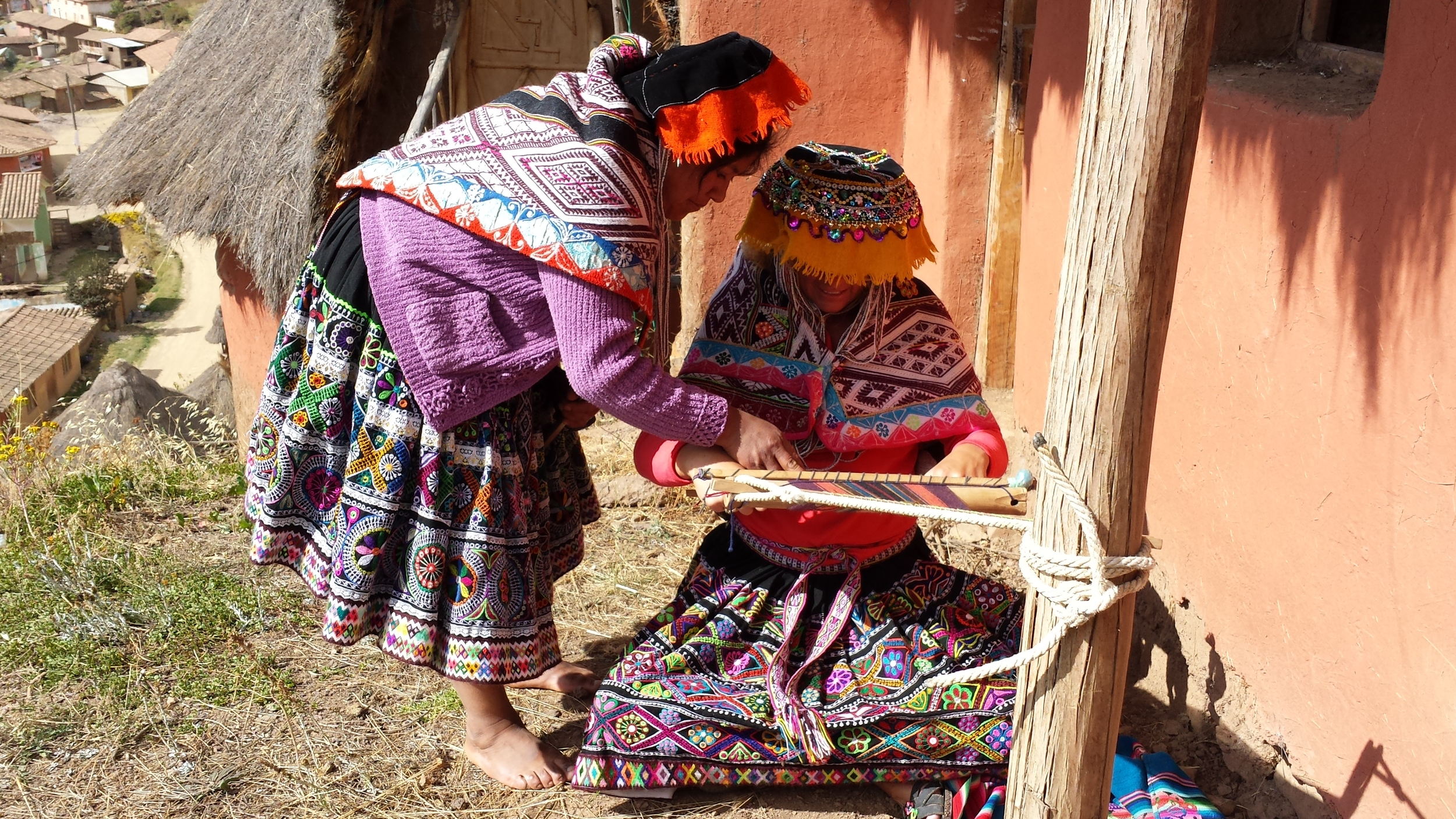 Indigenous woman teaching  how to weave her family pattern in Cuyo Grande, Peru