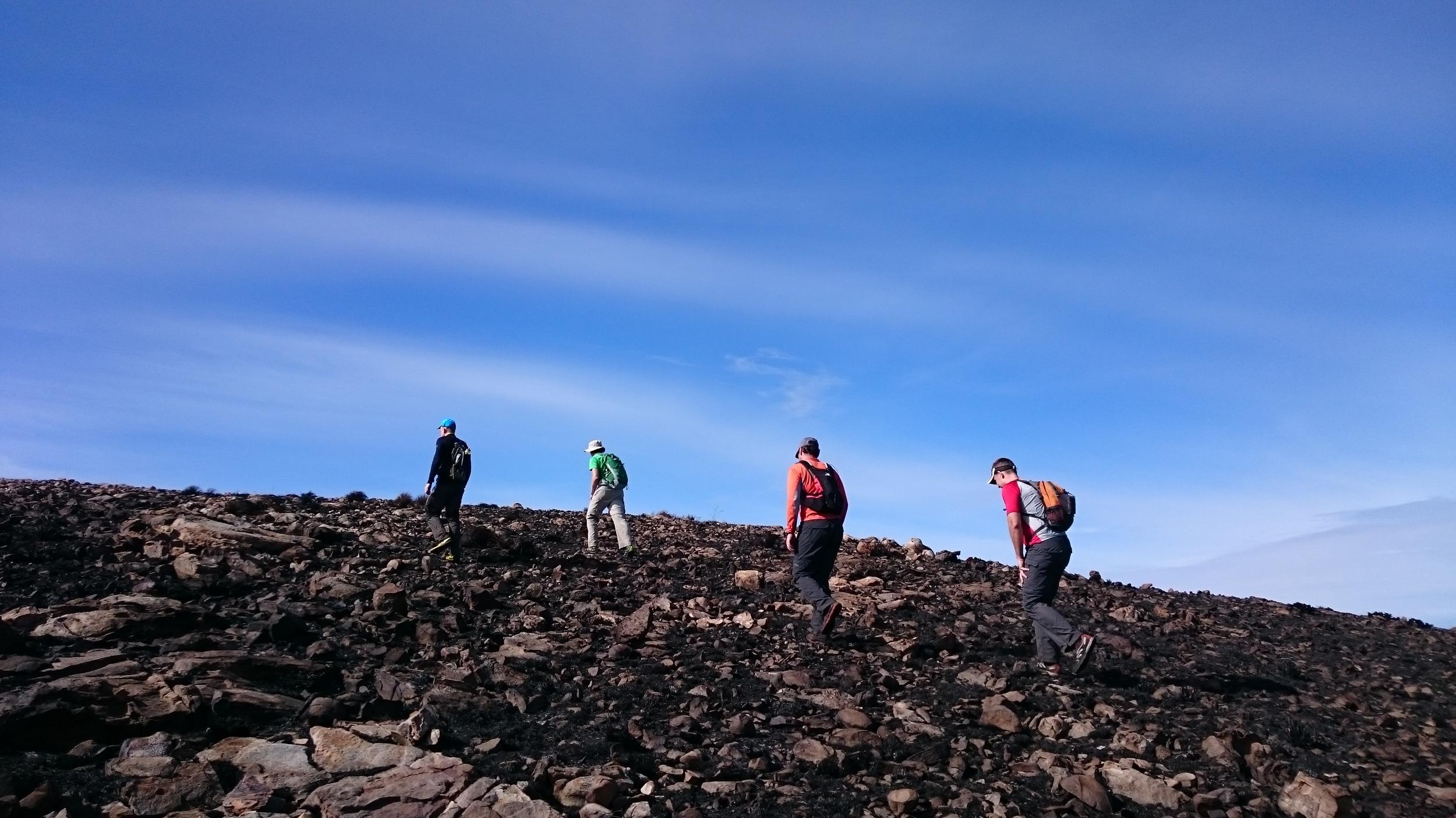 Hiking up one of the many burnt false peaks