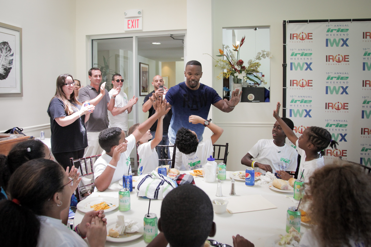 Youth Golf Clinic - Jamie Fox Reaching Out Towards Kids ME in back.jpg