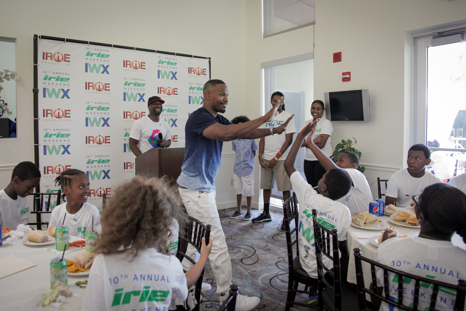 Youth Golf Clinic - Jamie Fox Double High Five with Kid wide shot.jpg