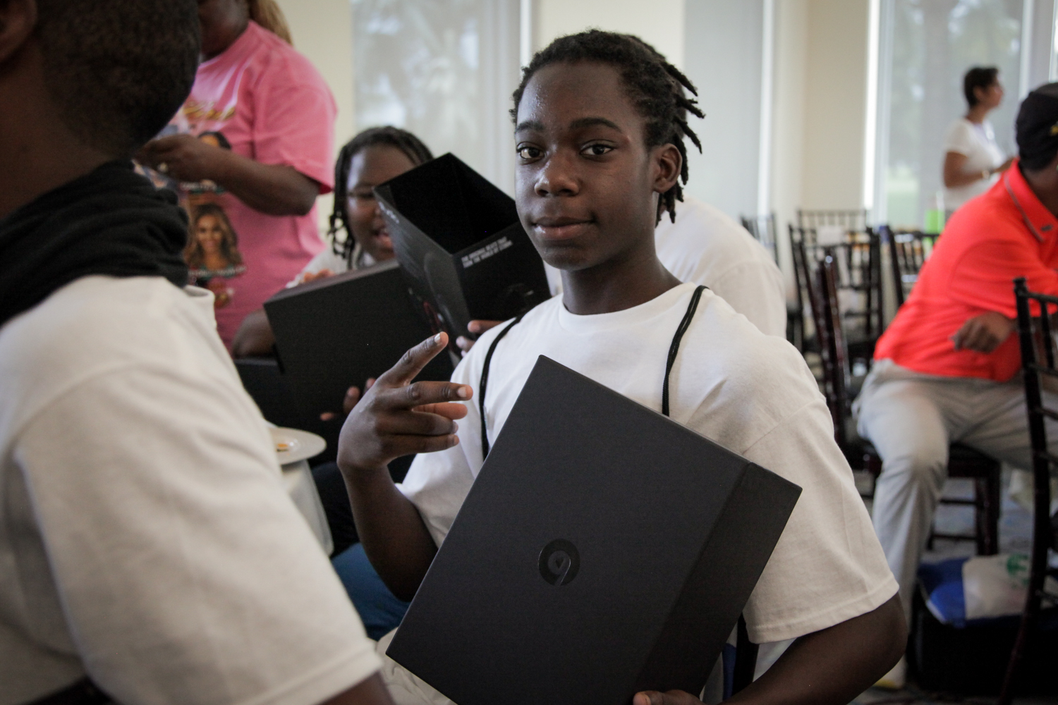 Youth Golf Clinic - Kid Peace Sign with Beats Box.jpg