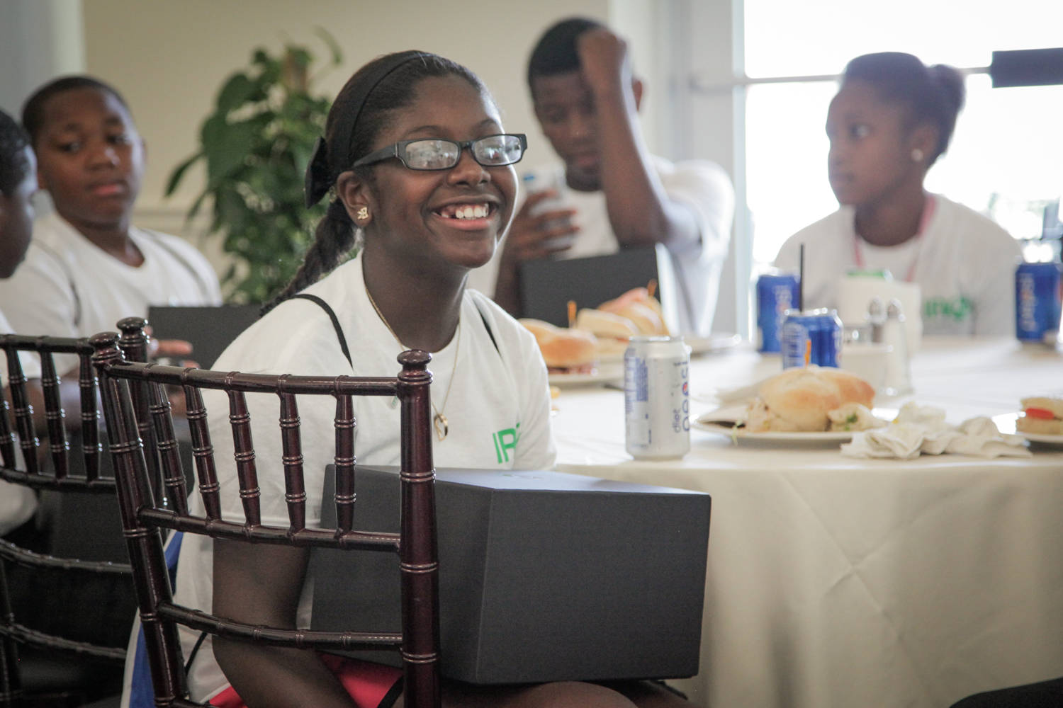 Youth Golf Clinic - Kids Smile with Beats Box.jpg