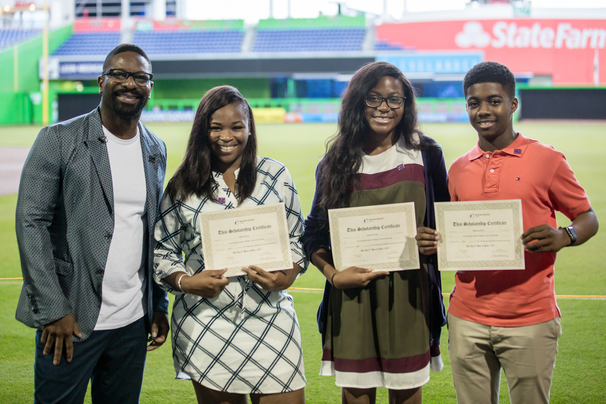 "Congratulations to Savannah Kelly, Khareem Oliver, and Ashley Spencer on being the first Theresa ""Boogie"" Grocher Scholarship recipients, awarded in honor of Irie's late mother. These high school seniors demonstrated an exemplary commitment to community service in the Miami-Dade area with a desire to continue in philanthropy outreach opportunities throughout college. IRiE presented each student, from Big Brothers Big Sisters Miami a $5,000 scholarship to be used towards their college expenses. We commend each student for their outstanding community service achievements and commitment to continuing education!"