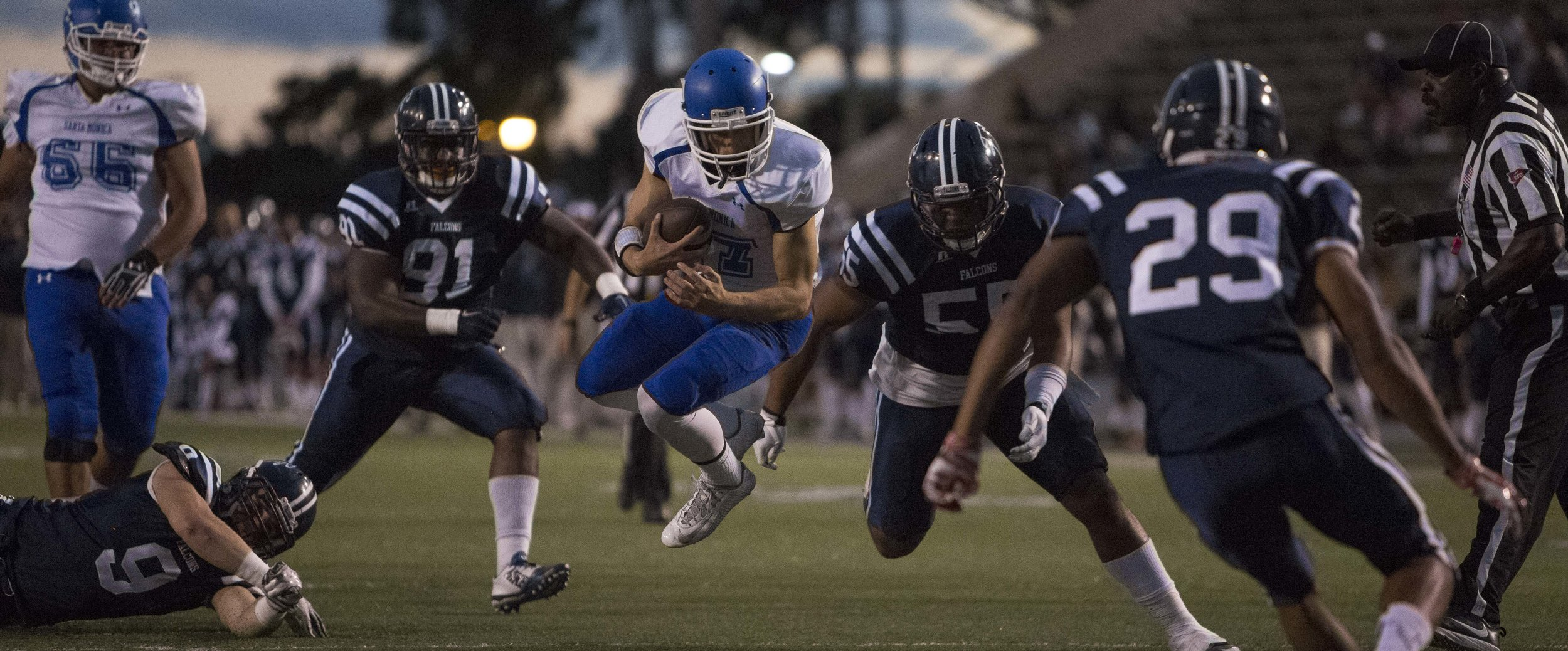 The Santa Monica College Corsair men's football team freshman quarterback #17 Weston Massett (white,center) makes a huge dive for a first down against The Cerritos College Falcona away in Cerritos , Calif. on October 17th, 2016 . The Corsairs would loose35-13. (Photo By: Daniel Bowyer/Corsair Staff)